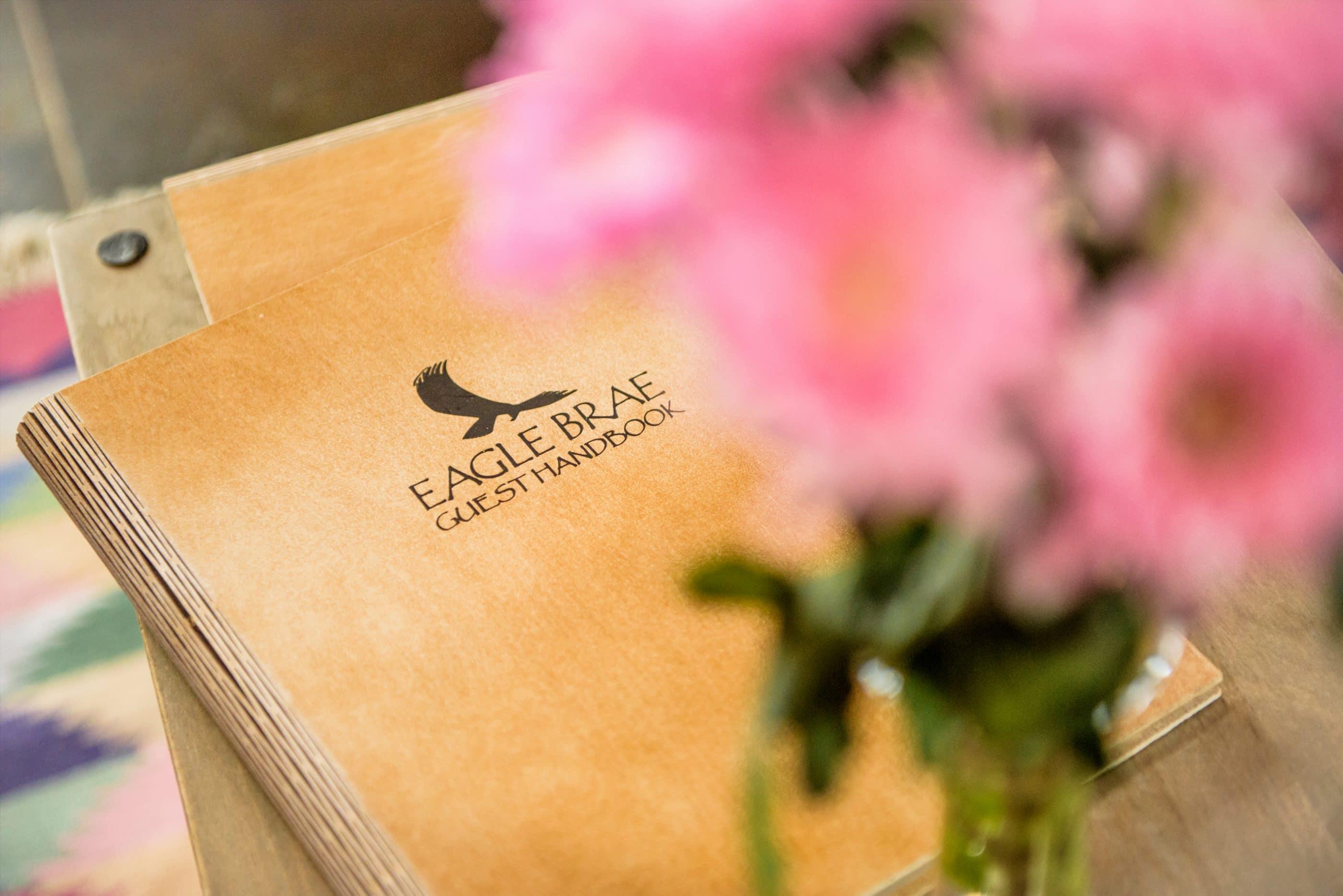 Eagle Brae guest book behind flowers