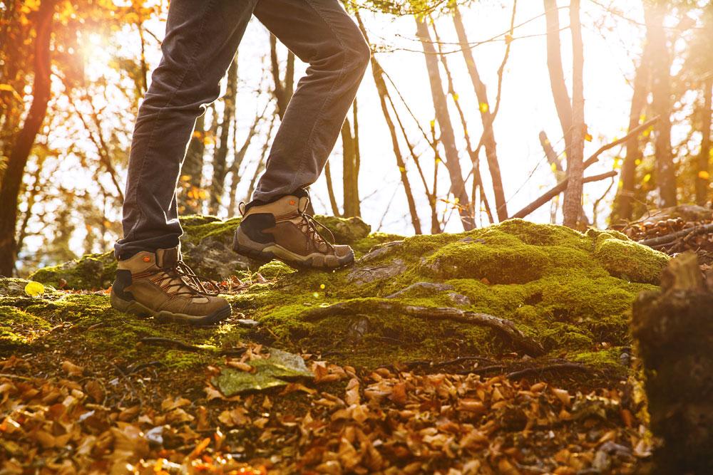 Hiker wearing walking boots in autumn